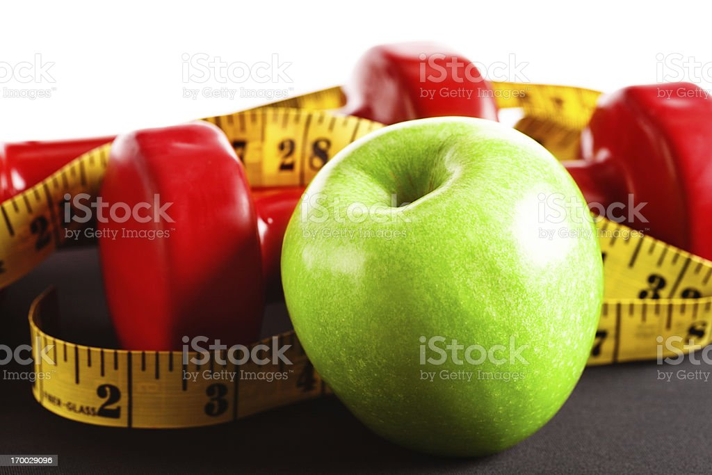 Get fit kit: apple, weights, and measuring tape stock photo