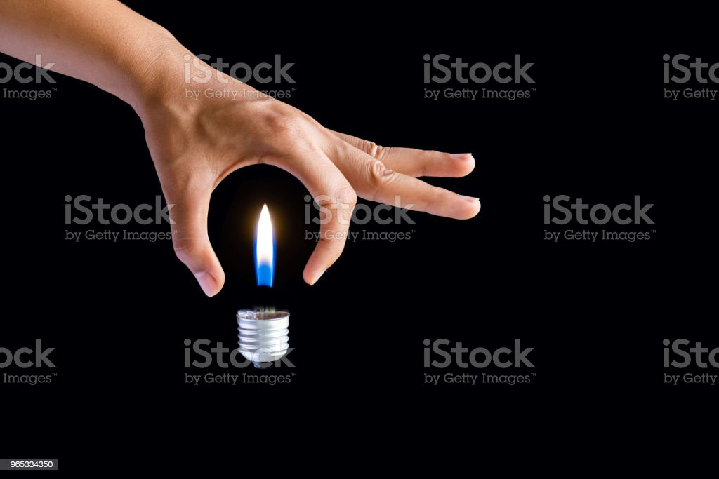 Get idea concept. business woman hand holding light bulb on black background royalty-free stock photo