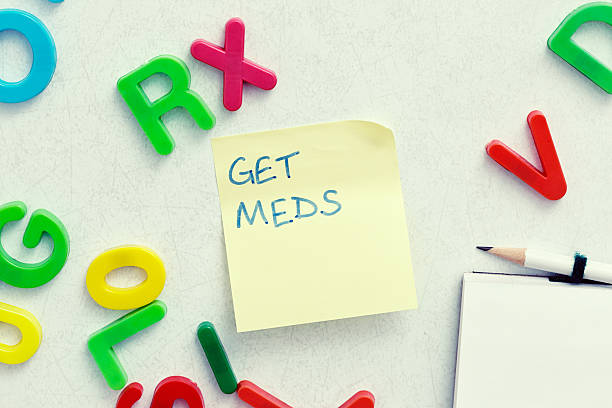 """""""get meds"""" and """"rx"""" messages on fridge door - prescription meds stock pictures, royalty-free photos & images"""
