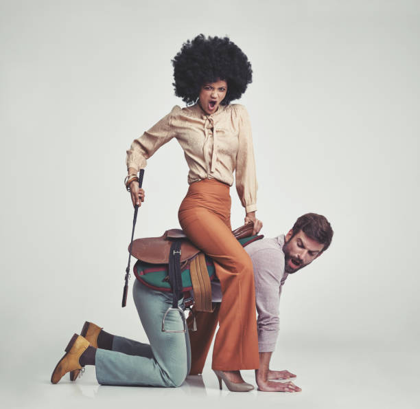 get moving! - man dominating woman stock photos and pictures