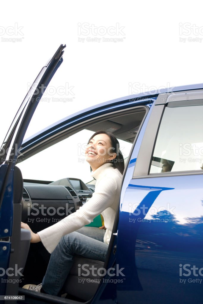 Get out the car and the woman royalty-free stock photo
