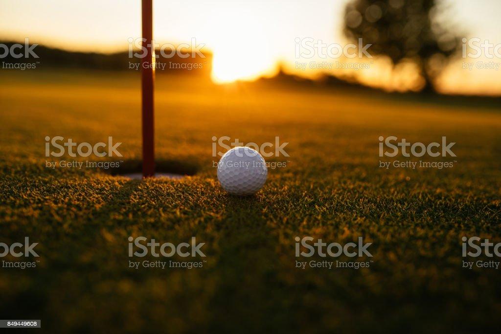 Shot of a golf ball on an empty course.