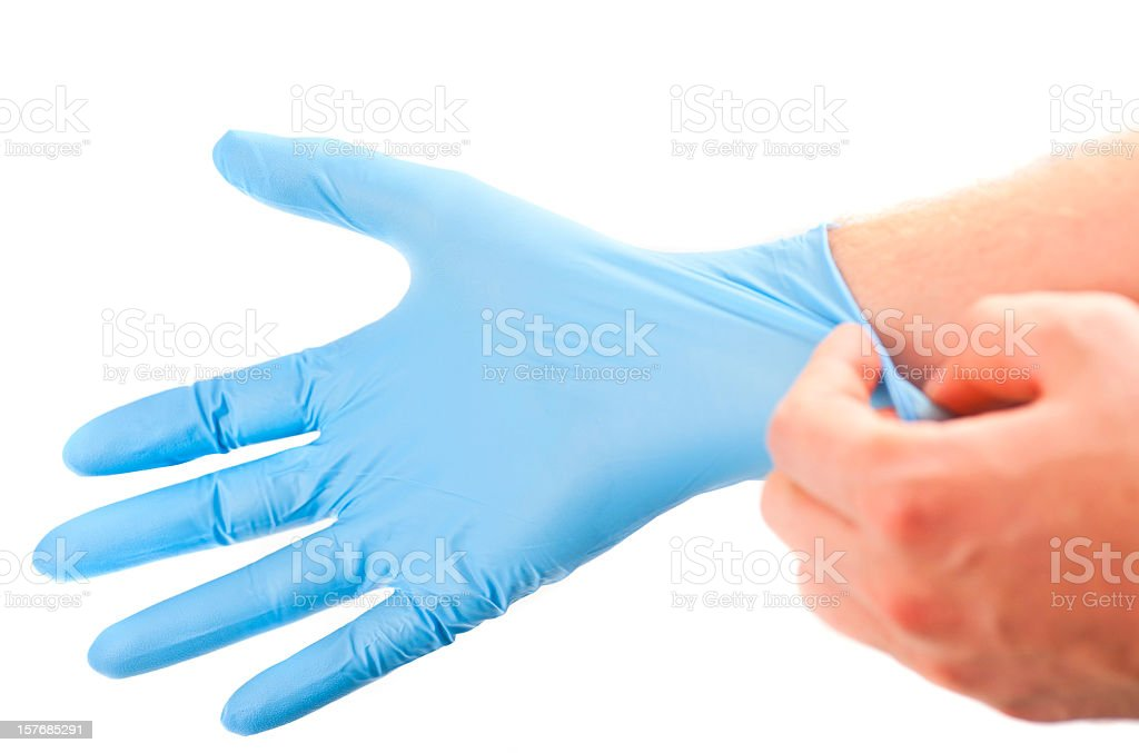 get ready for treatment doctors hand in blue hygienic glove stock photo