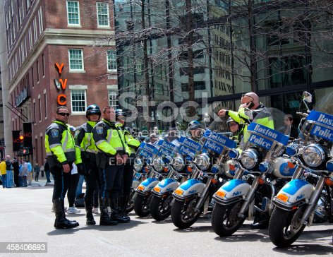 Boston, United States - April 15, 2013: Police man with motorbikes before the bombing at the Boston Marathon.