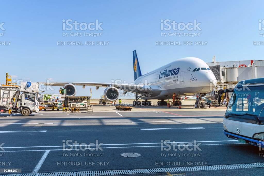 Get Ready to Fly - At Shanghai Pudong International Airport, the technicians are busy preparing a Lufthansa German Airline's Airbus A380-800 for another fly. stock photo