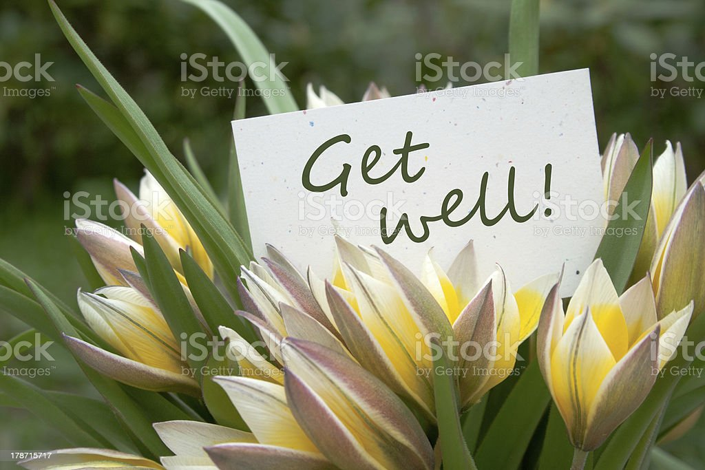 Get well card in a flower bouquet stock photo
