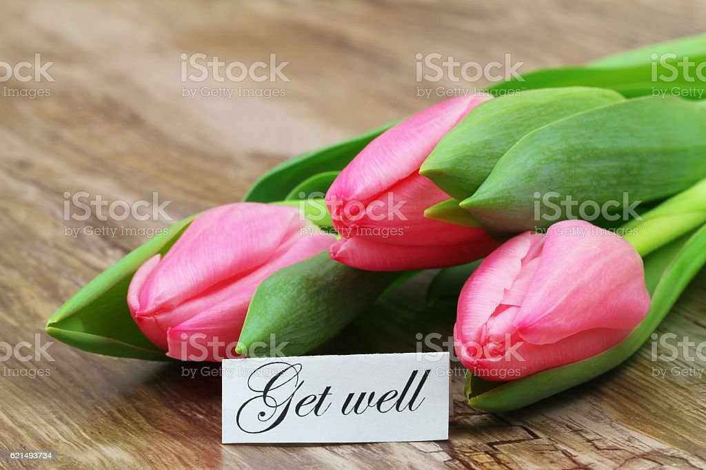 Get well card with pink tulips on wooden surface Lizenzfreies stock-foto