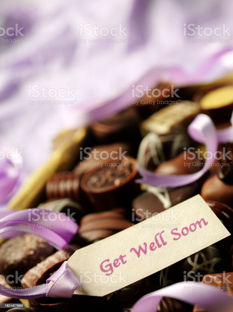 Get Well Soon Label, Ribbon and Chocolates royalty-free stock photo