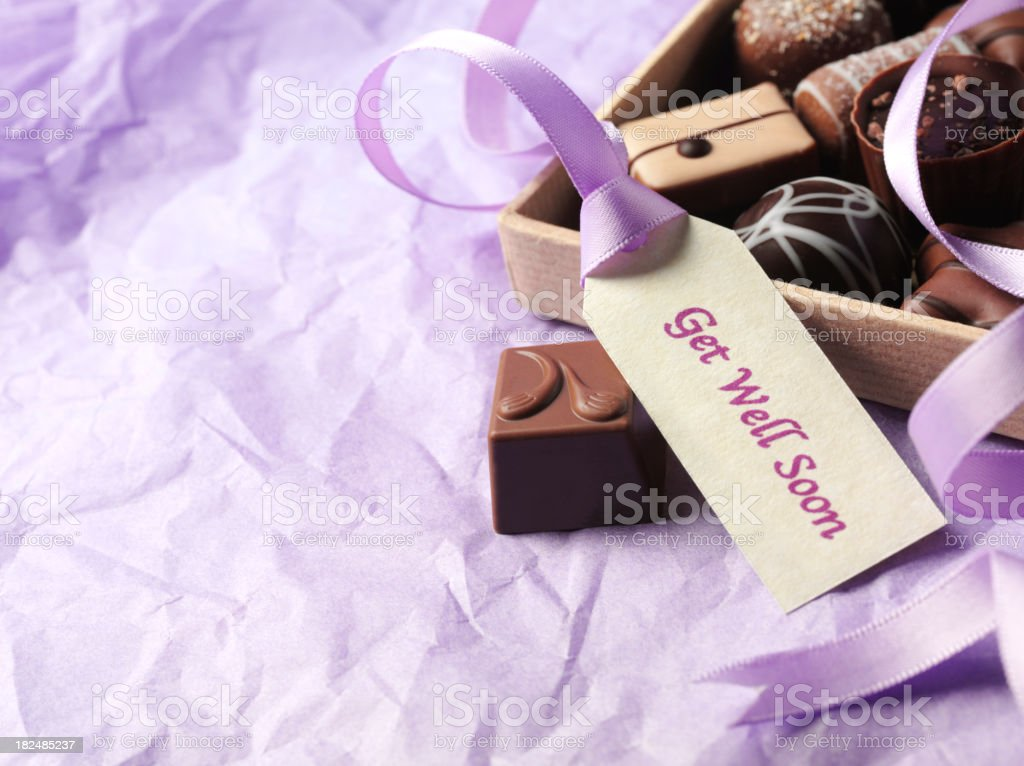 Get Well Soon Label, Ribbon and Chocolates stock photo