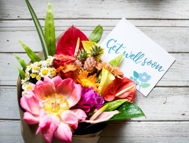Faire bien bientôt message avec bouquet - Photo