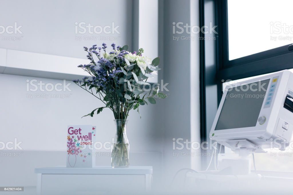Get well soon wishing card in hospital room stock photo