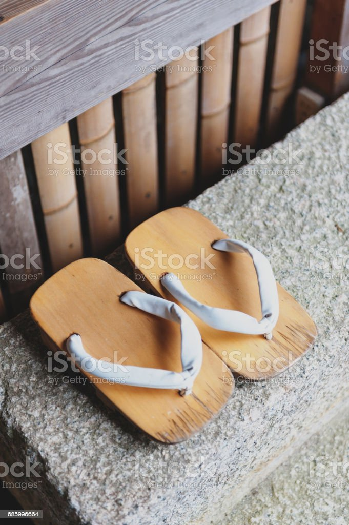 Geta or traditional Japanese footwear, a kind of flip-flops or sandal with an elevated wooden base held onto the foot with a fabric thong strap stock photo