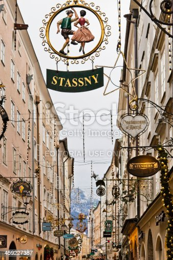 Salzburg, Austria - December 9, 2010: Wrought iron sign along the Getreidegasse. This is one of the most charming streets of Salzburg, lined with old buildings which house shops and restaurants, all characterized by beautiful wrought iron signs.