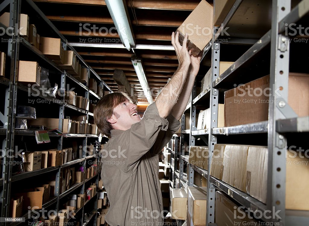 Getting a Box From the Warehouse royalty-free stock photo
