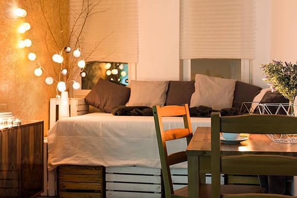 getting a comfortable look in your bedroom - schlafzimmer beleuchtung stock-fotos und bilder