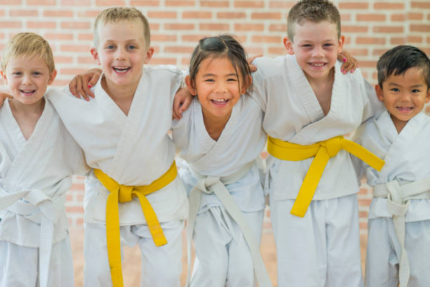 getting a yellow belt - karate stock photos and pictures