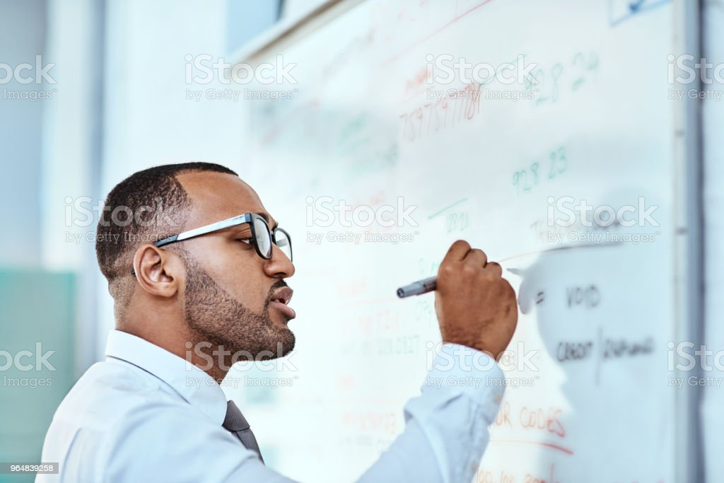 Getting all his ideas out on the board royalty-free stock photo