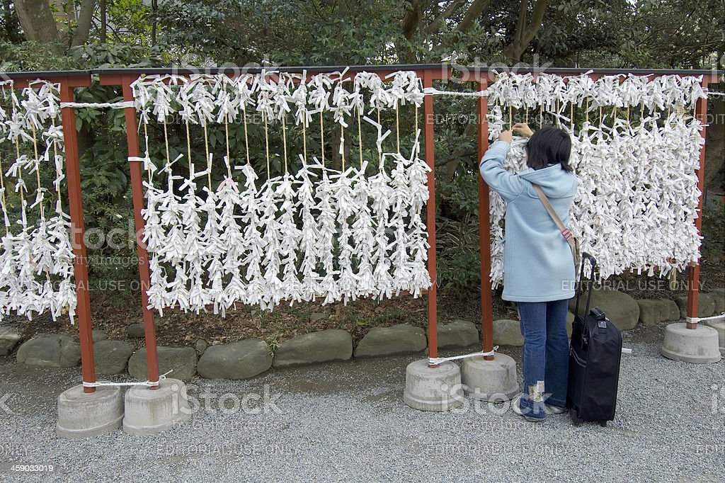 Getting an Omikuji royalty-free stock photo