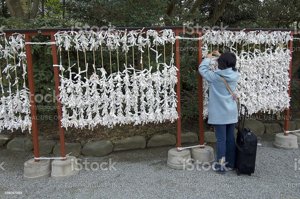 Getting an Omikuji royalty-free stock photo