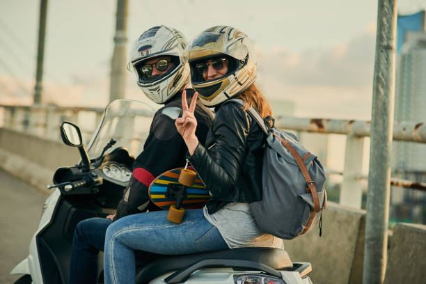 getting around town in a fun way - helmet motorbike imagens e fotografias de stock