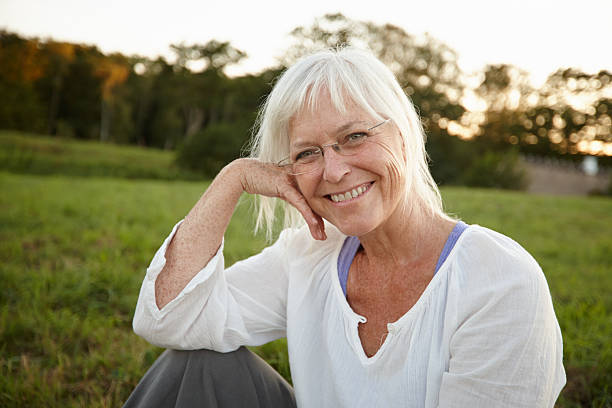 Getting away from it all Portrait of an attractive mature woman relaxing in nature one mature woman only stock pictures, royalty-free photos & images