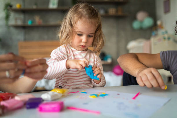 Getting creative with plasticine modeling clay Cute toddler girl making shapes of plasticine modeling clay, unrecognizable people next to her clay stock pictures, royalty-free photos & images
