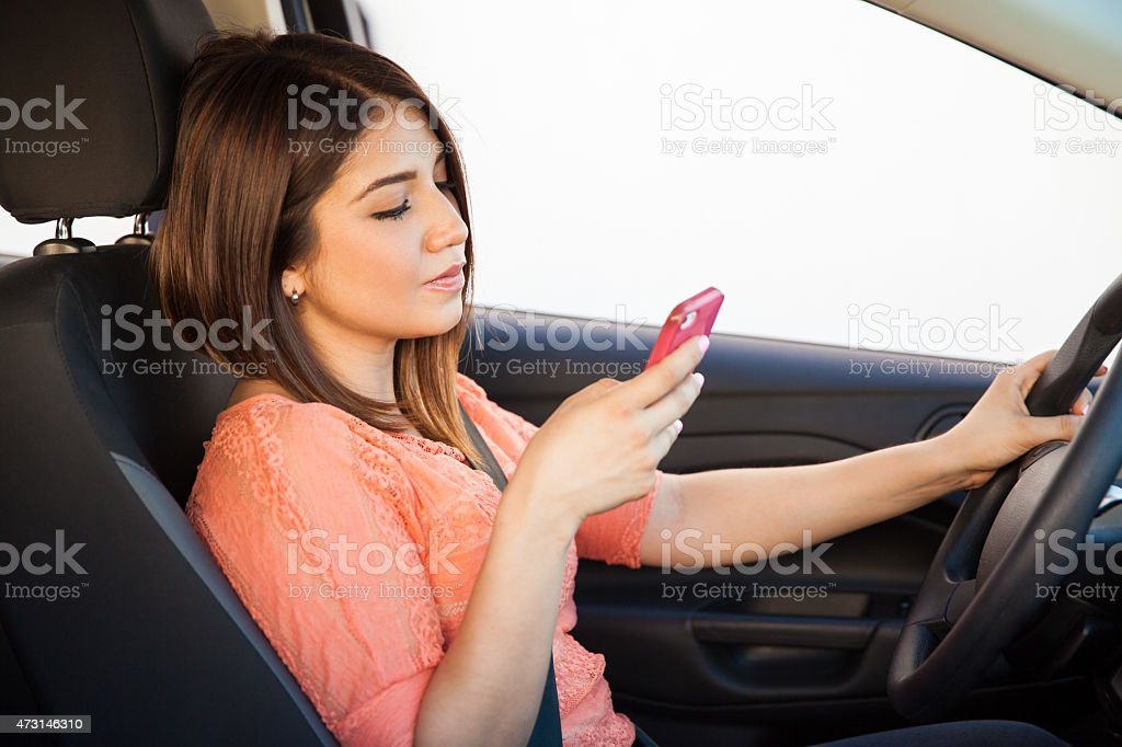Getting distracted while driving stock photo