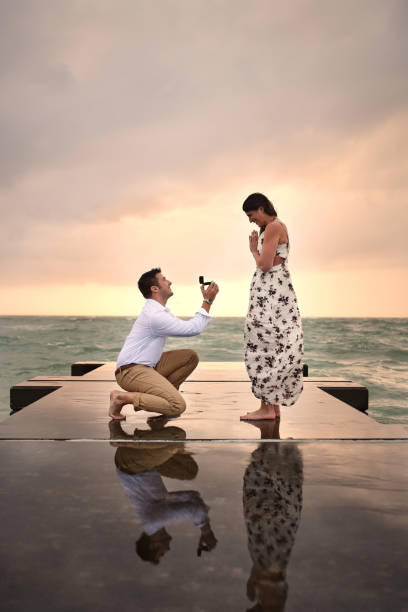Getting down on one knee stock photo
