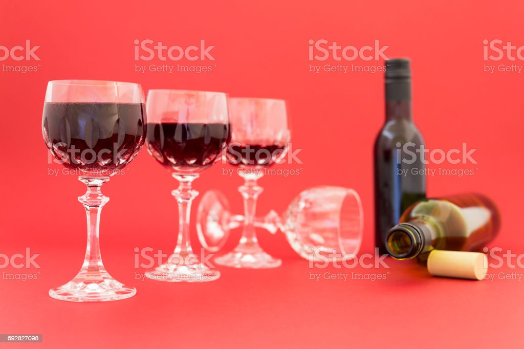 Getting drunk from red wine in elegant crystal glasses stock photo