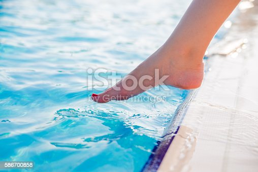 istock Getting  feel for the water, Toes dipping in water 586700858