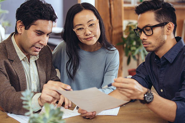 Getting financial advise Couple in the bank mortgages and loans stock pictures, royalty-free photos & images