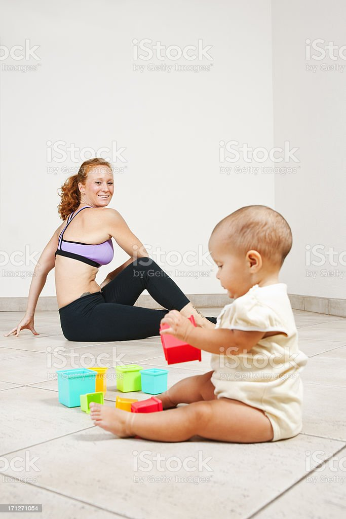 Getting fit with the baby stock photo