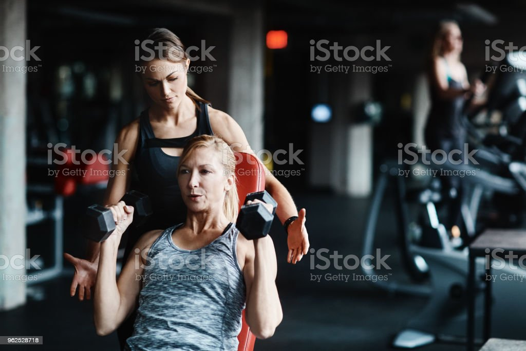 Getting fit with the best instructor - Royalty-free Adult Stock Photo