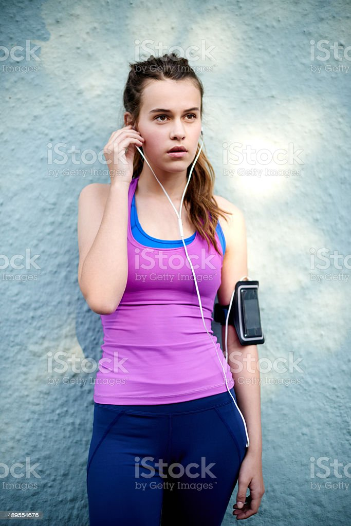 Getting focused before her run stock photo