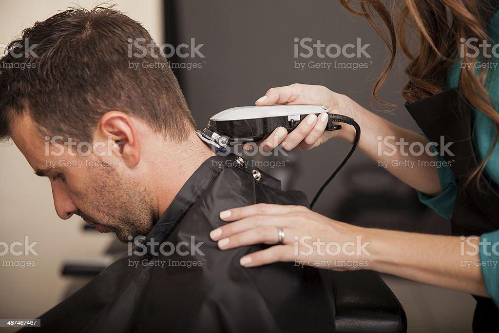 Getting haircut at a salon stock photo