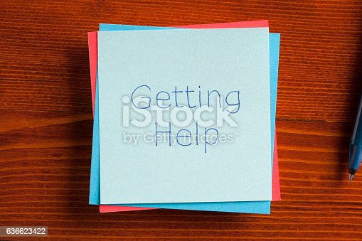 istock Getting Help written on a note 636623422