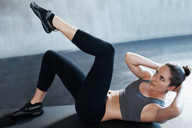 getting her abs nice and trim - sit ups stock photos and pictures