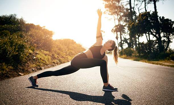 getting her mind and muscles in the workout zone - lunge stock photos and pictures