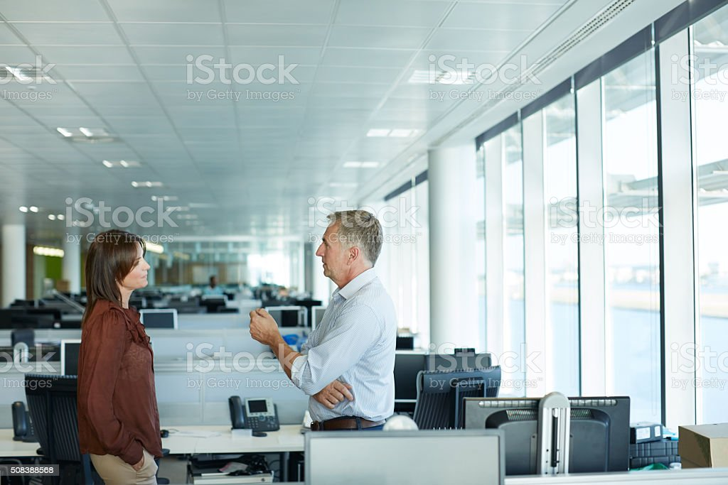 Shot of two businesspeople talking in the office
