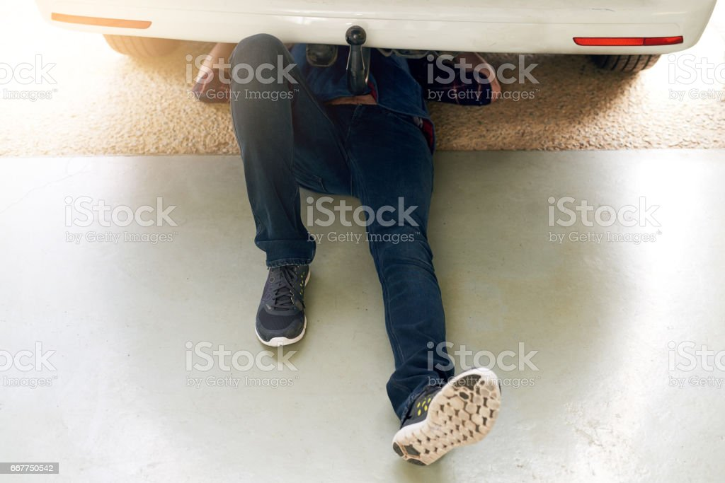 Getting his car back on the road stock photo