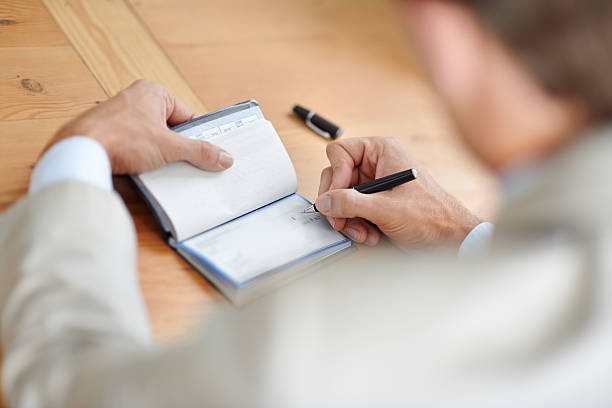 getting his checkbook organzied - blank check stock photos and pictures