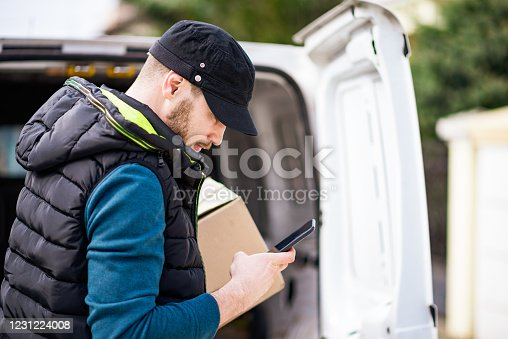 Delivery men getting his deliveries out of van. Food deliveries, groceries and supplies during COVID-19 isolation.