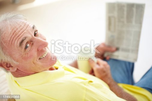 116379055 istock photo Getting his morning news 174934355