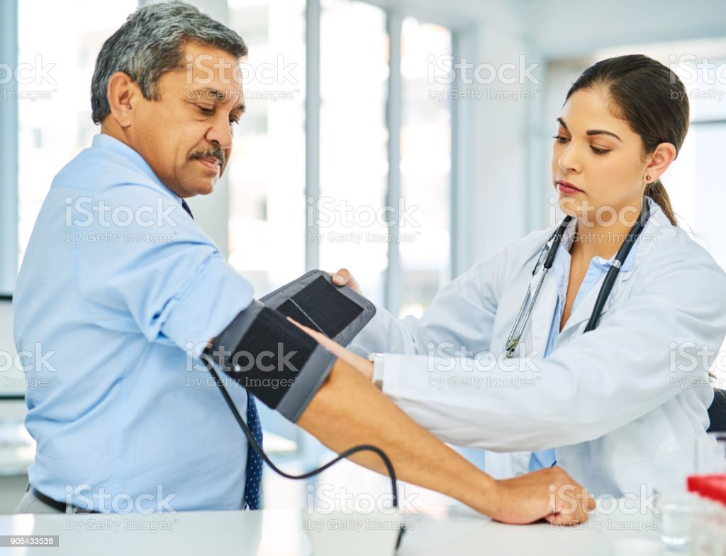 Getting his routine examination to ensure all is in check stock photo