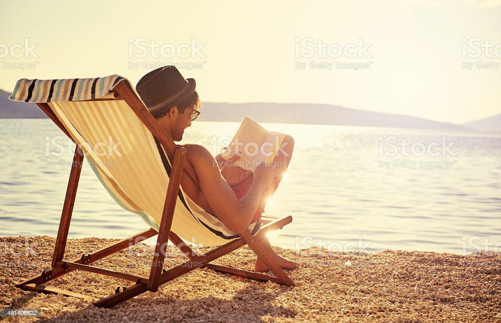 Getting lost in a good book stock photo