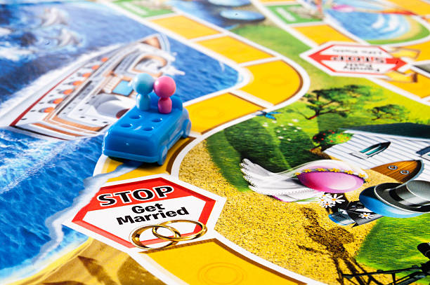 getting married in the game of life - game of life stock photos and pictures