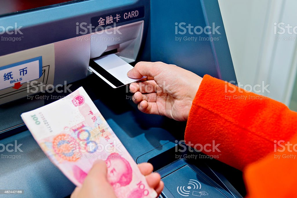 getting money from atm stock photo