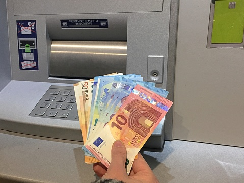 Getting Money From The Atm Stock Photo - Download Image Now