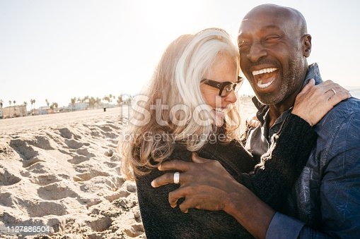Senior couple laughing on the beach