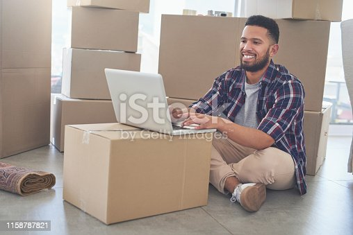 istock Getting my emails done before unpacking more 1158787821